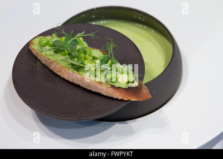 Creamy pea soup served at Guy Savoy's Le Chiberta restaurant Paris France - Stock Image