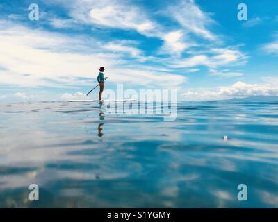 A female stand up paddling. Tavarua Fiji. - Stock Image