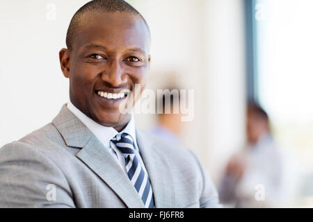 close up portrait of happy African businessman - Stock Image