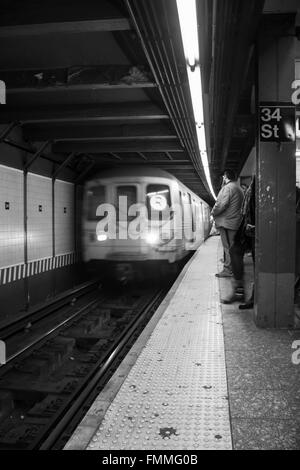 Subway Train coming into the station - Stock Image
