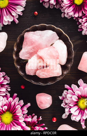 Rose Quartz and Pink Mums on Dark Wood - Stock Image