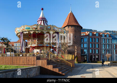 Carousel on waterfront in Gdansk, Poland - Stock Image