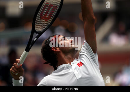 Flushing Meadows, New York, USA. 30th Aug 2018. August 30, 2018: US Open Tennis:  Roger Federer of Switzerland serving to Benoit Paire of France during their second round match at the US Open in Flushing Meadows, New York. Credit: Adam Stoltman/Alamy Live News - Stock Image