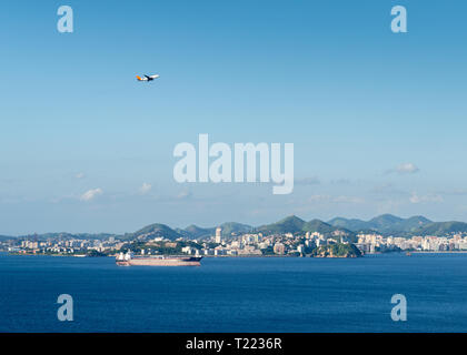 Container ship in import export and business logistic with airplane in sky - logistics concept. - Stock Image