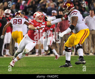 December 19, 2015. Vince Biegel #47 of Wisconsin battles Zach Banner #73 of USC during the 2015 National Education - Stock Image