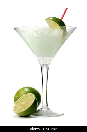 A cocktail drink in a stemmed glass with a green lime garnishes. - Stock Image