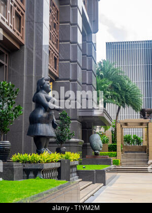 Fernando Botero sculpture Dressed Woman in the Parkview Square forecourt Singapore. - Stock Image