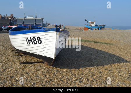 Boats on the beach at Aldeburgh in Suffolk are antique fishing vessels of the kind that inspired Benjamin Britten's opera Peter Grimes. - Stock Image