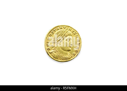 Gold coin depicting the bust of Emperor Constantine the Great. Isolated over white - Stock Image