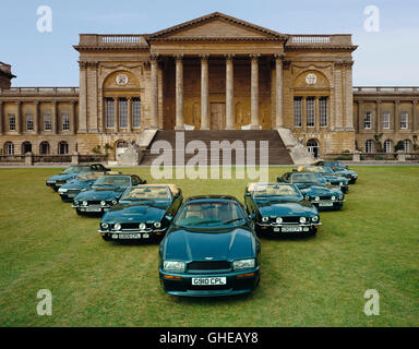 Nine 1990 Aston Martins in V formation on the lawns of Stowe public school Country of origin United Kingdom - Stock Image