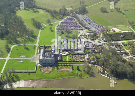 Aerial view of Longleat House shown with it's formal gardens and lake. The stately home is famous for it's - Stock Image
