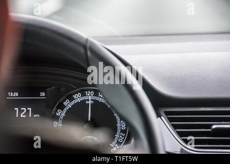 Hands on the steering, driving car over speed limit - Stock Image