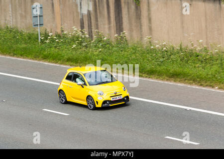 Abarth 595 sports hatchback car on the M61 motorway near Farnworth,  Abarth cars are a subsidiary of FCA Italy S.p.A. - Stock Image