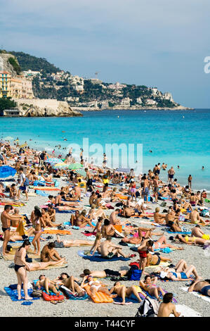 Nice Cote dAzur France - a crowded Promenade des Anglais beach - Stock Image