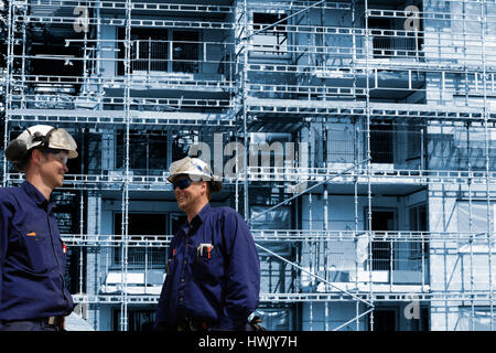 building workers and scaffoldings - Stock Image
