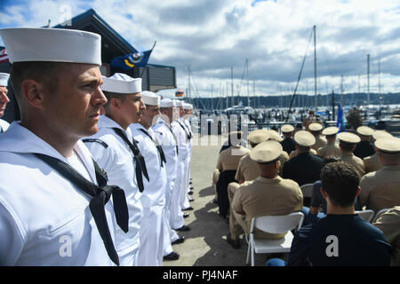 180831-N-VH385-0010  BREMERTON, Wash. (Aug. 31, 2018) - Chief petty officer (CPO) selectees stand in formation during the CPO Legacy Academy graduation in front of the museum ship USS Turner Joy. The selectees spent the week living, working, and training aboard the Vietnam War-era ship along with a group of CPO mentors who provided leadership and training on Naval history as well as the heritage of the CPO community. (U.S. Navy photo by Mass Communication Specialist 2nd Class Wyatt L. Anthony/Released) - Stock Image