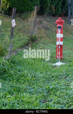 roadside hydrant pouring water into a ditch in a rural village zala county hungary - Stock Image