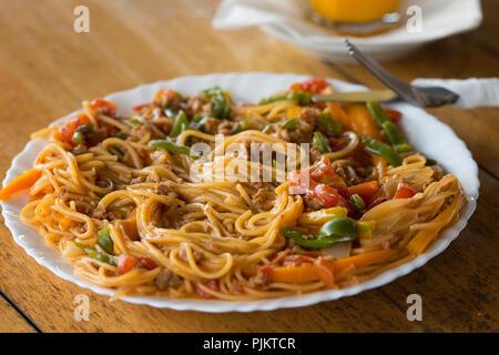 Spaghetti Bolognese, Pasta served at Restaurant in Lake Mburo National Park, Safari Dining, Uganda, East Africa - Stock Image