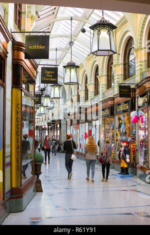 Norwich arcade, view of people walking inside the Royal Arcade in Norwich city centre, Norfolk, UK - Stock Image