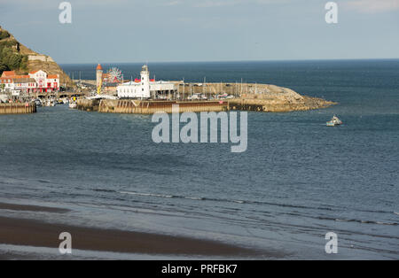 Scarborough harbour and lighthouse. unsharpened - Stock Image