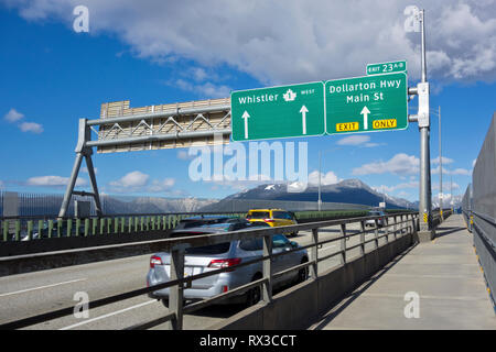 Traffic driving over Ironworkers memorial Bridge in Vancouver, BC, Canada.  Northbound highway 1 bridge crossing to North Vancouver. - Stock Image