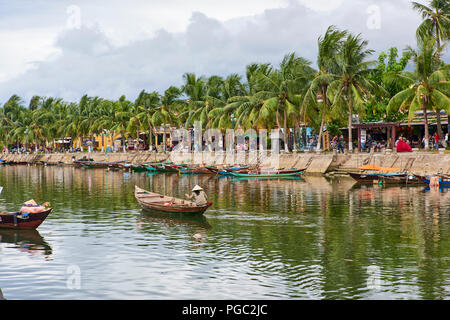 The main canal in the UNESCO World Heritage Site town of Hoi An, in Central Vietnam. - Stock Image
