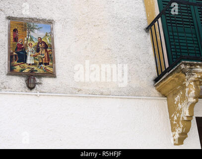 Religious paining on the wall of a house in the hilltop town of Bernalda in Basilicata, Southern Italy - Stock Image