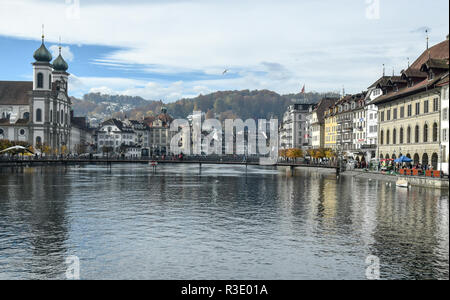 A view of Lucerne and the Old Town looking back from the timber bridge. - Stock Image