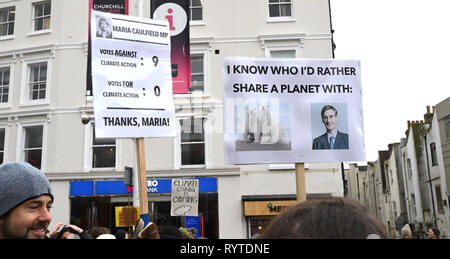 Brighton, UK. 15th Mar, 2019. message for Maria Cauldfield MP as thousands of students schoolchildren and parents march through Brighton as they take part in the second Youth Strike 4 Climate protest today as part of a co-ordinated day of global action. Thousands of students and schoolchildren are set to go on strike at 11am today as part of a global youth action protest over climate change Credit: Simon Dack/Alamy Live News - Stock Image