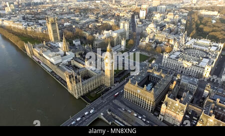London Aerial Cityscape with Landmarks including the Thames, Big Ben Clock Tower and Parliament Palace, Portcullis House and Westminster Square Garden - Stock Image