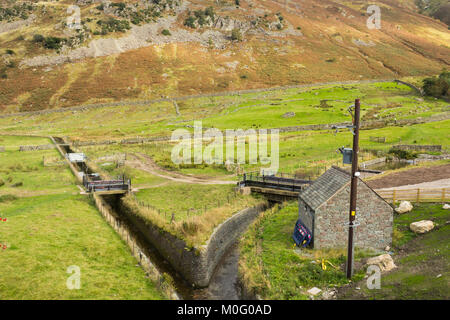 Water drainage channels near Swirls, at the foot of Helvellyn and Brown Crag on the Eastern Fells of the English - Stock Image