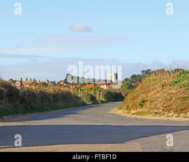A view of the village and church tower from the beach access road in North Norfolk at West Runton, Norfolk, England, United Kingdom, Europe. - Stock Image