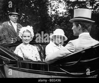 Grace Kelly, Princess of Monaco, left, in a horse drawn carriage. - Stock Image