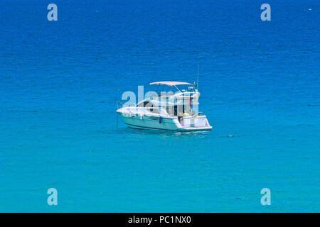Tourist boat near  Sant Vicen - Stock Image