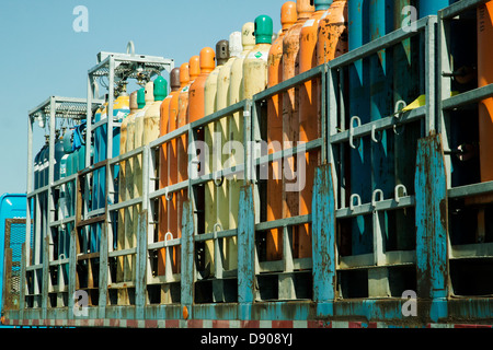 Colorful liquid gas(helium) tanks carried by truck - Stock Image