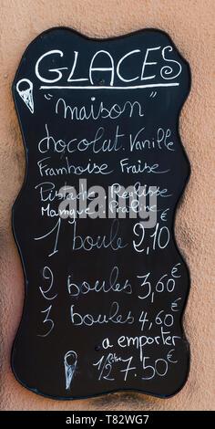 Blackboard handwritten menu outside a french ice cream shop - Stock Image