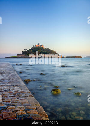 St Michael's Mount at Marazion, Cornwall, UK at evening, with part of the causeway linking it to the mainland. - Stock Image