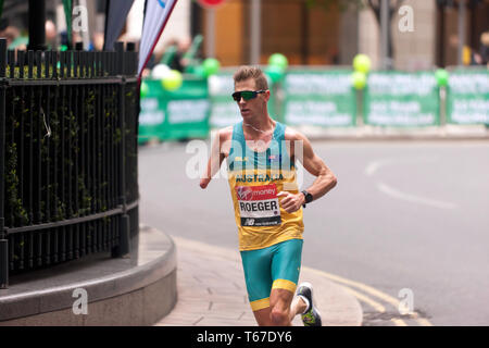 Paralympic athlete,  Michael Roeger, (AUS), competing in the 2019   London Marathon. He finished first in the  T45/46 Category, in a time of  02:22:51 - Stock Image
