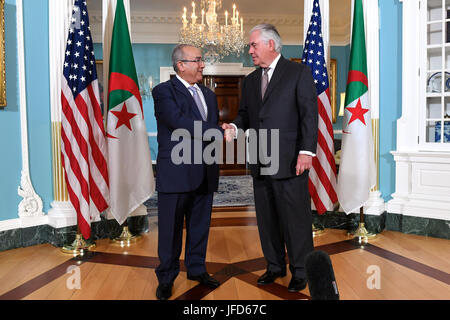 U.S. Secretary of State Rex Tillerson speaks with Algerian Foreign Minister Ramtane Lamamra before their bilateral - Stock Image
