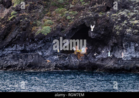Christmas installation of a Bethlehem Crib scene, a Belen, in a cave by the sea in Garachico, Tenerife, Canary Islands, Spain - Stock Image