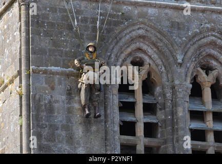 Sainte-Mere-Eglise, Normandy, France, May 15, 2018 DDAY Memorial for the american Paratrooper ' John Steele' on the pinnacle of the church tower - Stock Image