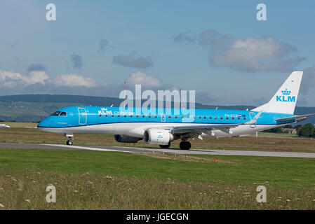 KLM Amsterdam scheduled flight arriving at Inverness Airport in the Scottish Highlands. - Stock Image