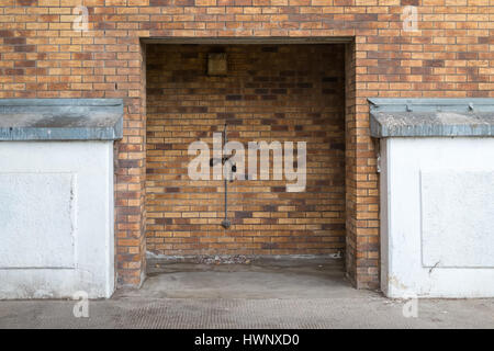 Empty doorway in a carpark. - Stock Image