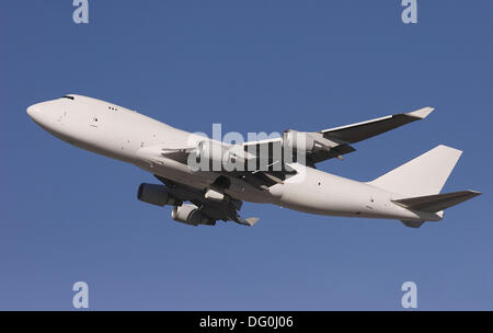 Unmarked Boeing 747 shortly after take-off - Stock Image