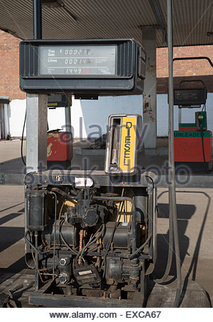 Disused diesel pump with its workings exposed at abandoned  service station, Liverpool - Stock Image