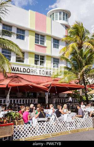 Miami Beach Florida Ocean Drive New Year's Day Art Deco District Waldorf Tower restaurant alfresco al fresco dining diners wom - Stock Image