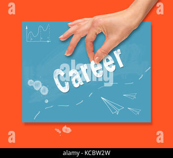 A hand picking up a Career concept on a colorful drawing board. - Stock Image