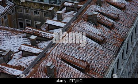 Snow covered roof tiles in Venice, Italy - Stock Image