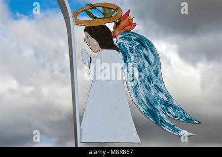 Angel at gate at Our Lady of Sorrows Church in Manzano, New Mexico, USA - Stock Image