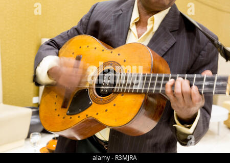 Cuba, Havana. Hands in motion playing guitar. Credit as: Wendy Kaveney / Jaynes Gallery / DanitaDelimont.com - Stock Image
